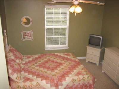 Another angle of the Bedroom with a Television