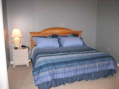 The Master Bedroom has a King size bed and Private Full Bathroom